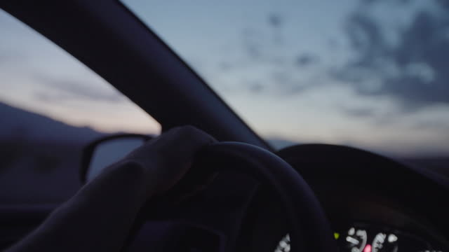 closeup of hand on steering wheel while driving - wheel stock videos & royalty-free footage