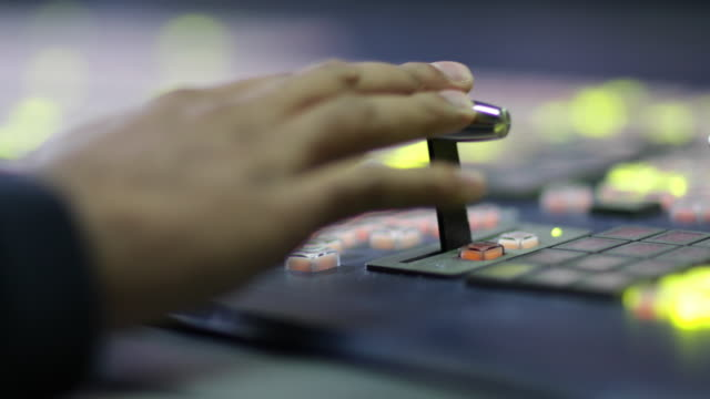 close-up of hand operating tv control room technology - concentration stock videos & royalty-free footage