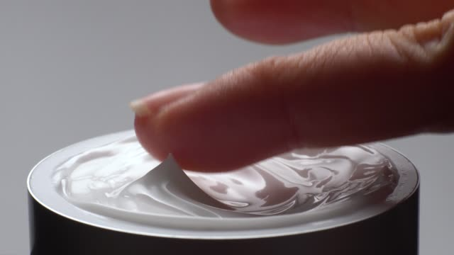 close-up of hand touching on cream moisturizer product. - beauty treatment stock videos and b-roll footage