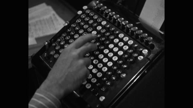 close-up of hand working on adding machine in office - addierrolle stock-videos und b-roll-filmmaterial