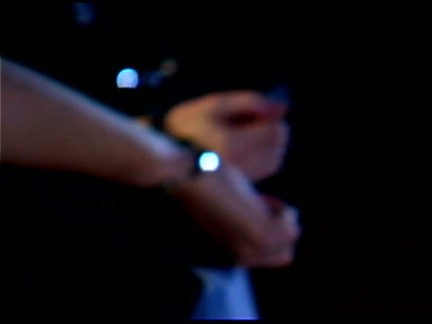 Close-up of hands in handcuffs