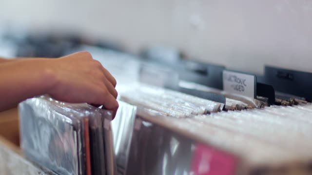 closeup of hands looking through records in a store - collection stock videos and b-roll footage