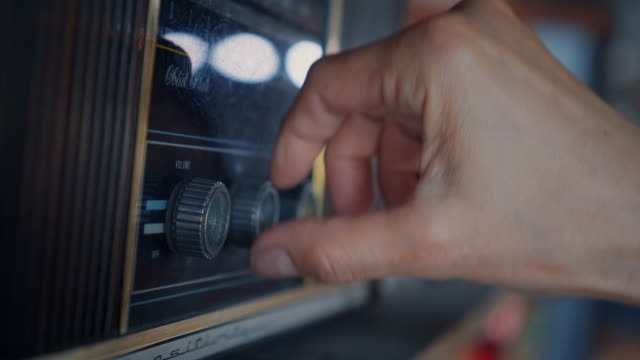 close-up of hands using analog vintage radio - old fashioned stock videos & royalty-free footage