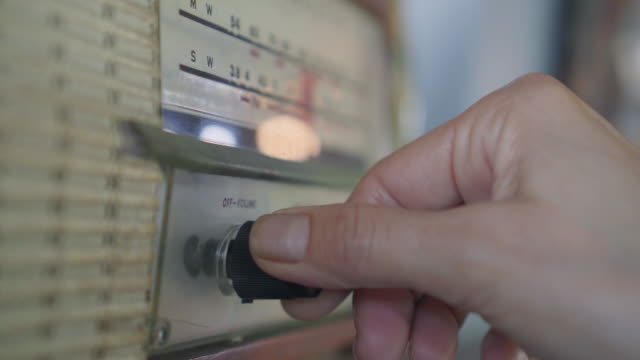 close-up of hands using analog vintage radio - knob stock videos & royalty-free footage