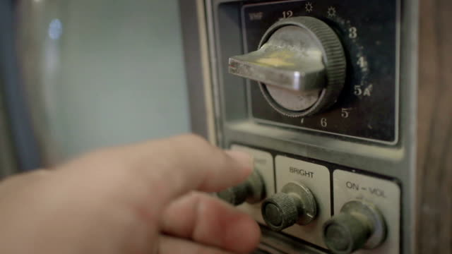 close-up of hands using old television - start button stock videos & royalty-free footage