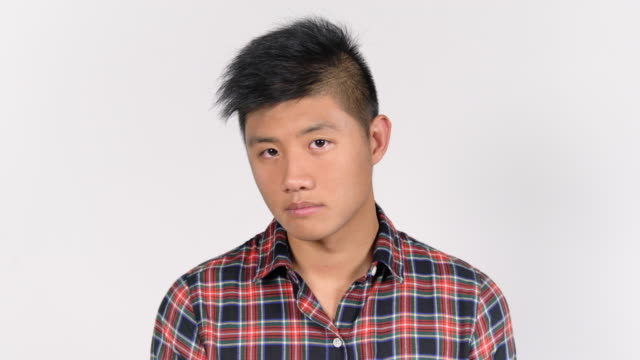 close-up of handsome young man in plaid shirt - plaid shirt stock videos & royalty-free footage