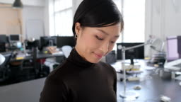 Close-up of happy young asian businesswoman