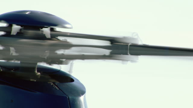 close-up of helicopter's spinning rotor blades. - helicopter rotors点の映像素材/bロール