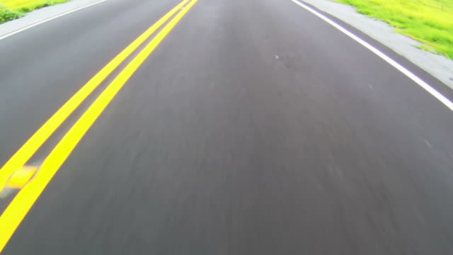 Close-up of highway while moving along the yellow line