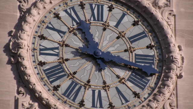 close-up of historical clock tower face at paris gare de lyon station - clock tower stock videos & royalty-free footage