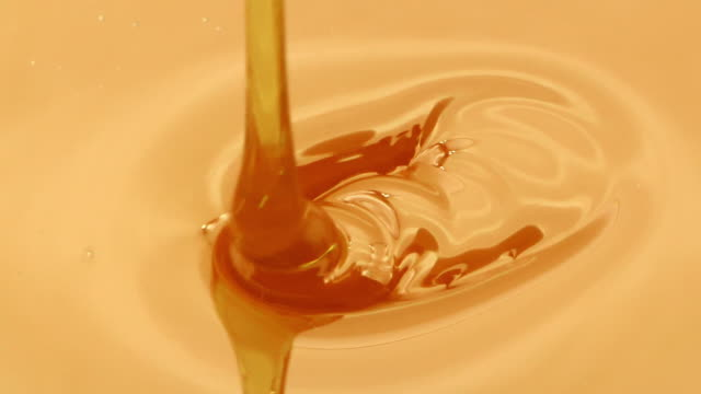 close-up of honey falling - syrup stock videos & royalty-free footage