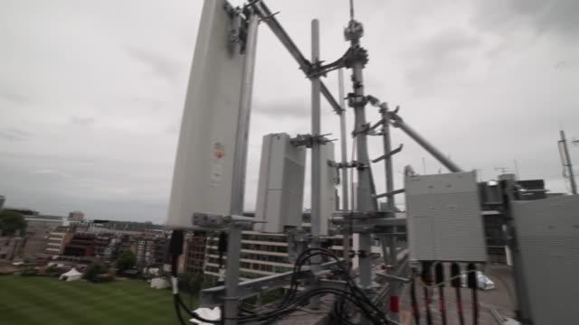 vidéos et rushes de closeup of huawei 5g network equipment in birmingham - west midlands