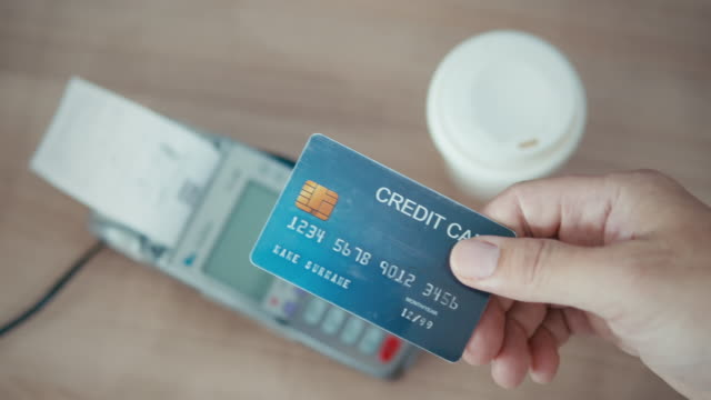 close-up of human hand giving the credit card to the salesperson,slow motion - beak stock videos & royalty-free footage