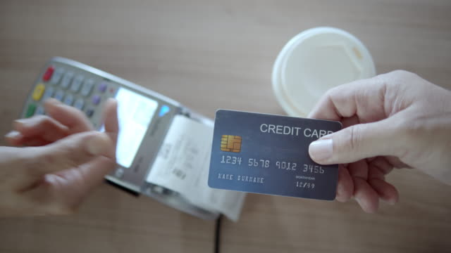 close-up of human hand giving the credit card to the salesperson,slow motion - credit card purchase stock videos & royalty-free footage