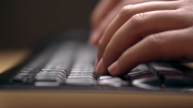 close-up of human hands typing computer keyboard working at home - hot desking stock videos & royalty-free footage