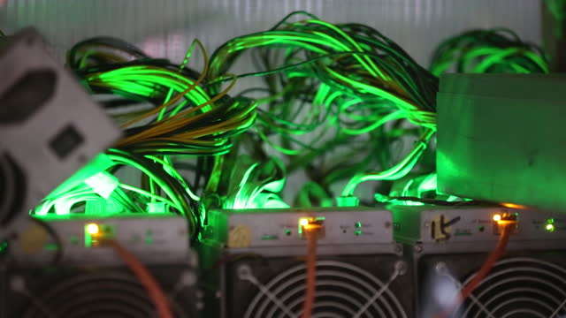 stockvideo's en b-roll-footage met close-up of illuminated cables and diodes at the cryptouniverse cryptocurrency mining farm in nadvoitsy, republic of karelia, russia, on thursday,... - mining