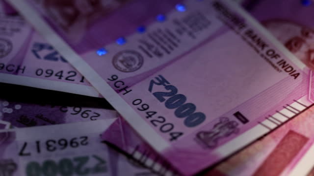 close-up of indian two thousand banknotes - banknote stock videos & royalty-free footage