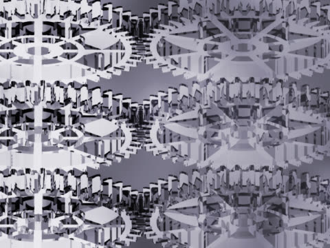 close-up of interlocked gears spinning - manipolazione di colore video stock e b–roll