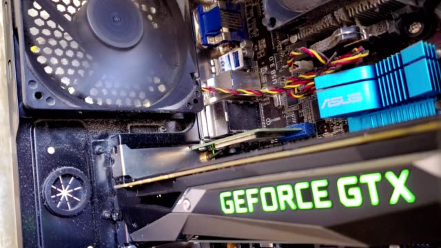 stockvideo's en b-roll-footage met close-up of internal components, including an nvidia 1070 gpu graphics card, of a personal computer engaged in mining cryptocurrency, including... - mining