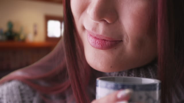 closeup of japanese woman holding a cup of tea - jumper stock videos & royalty-free footage