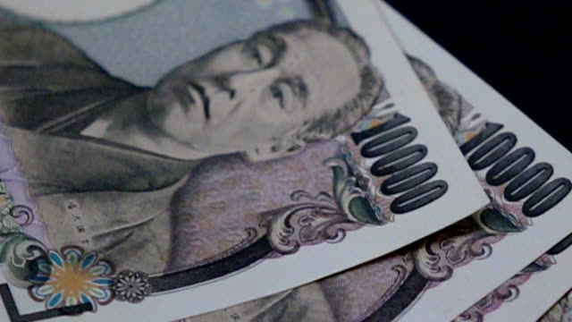 closeup of Japanese yen bank noted with high speed camera