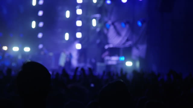close-up of jumping crowd at concert - nightlife stock videos & royalty-free footage