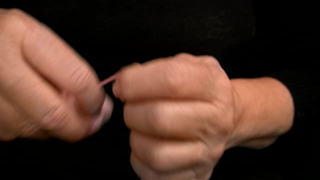 closeup of lady's hands winding wool into a ball - ball of wool stock videos & royalty-free footage