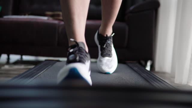 close-up of leg running on treadmill - treadmill stock videos & royalty-free footage