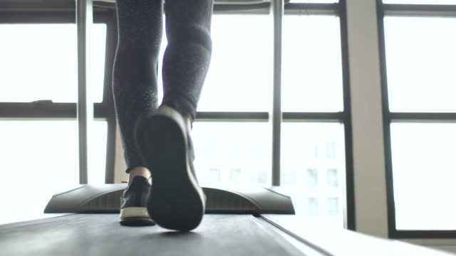 close-up of leg walking on treadmill - racewalking stock videos and b-roll footage