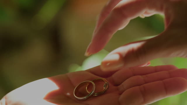 close-up of lesbian's hand taking ring from her bride - black woman giving birth stock videos & royalty-free footage