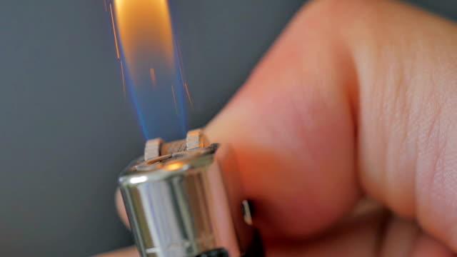 Close-up of lighter igniting on black background,Slow Motion