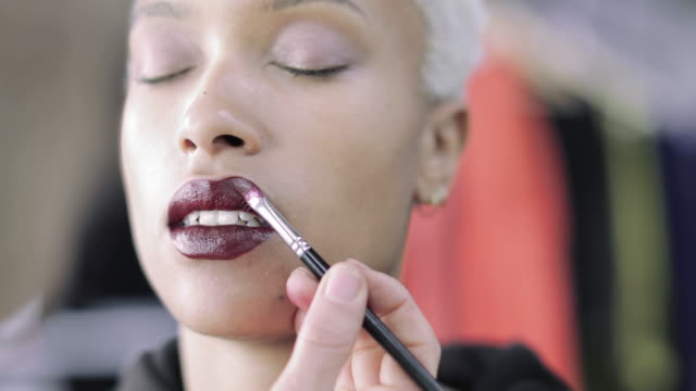 closeup of lipstick being applied by a makeup artist - fashion show stock videos & royalty-free footage