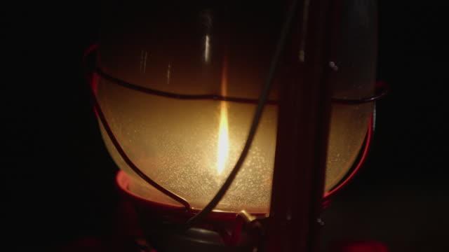 close-up of lit lantern - lanterna attrezzatura per illuminazione video stock e b–roll