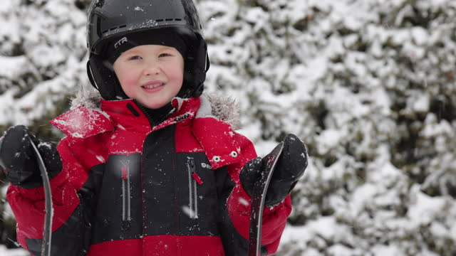 close-up of little boy wearing sports helmet and skiing outdoors in winter - helmet stock videos & royalty-free footage