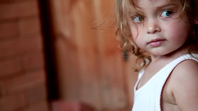 close-up of little girl looking around - shy stock videos & royalty-free footage