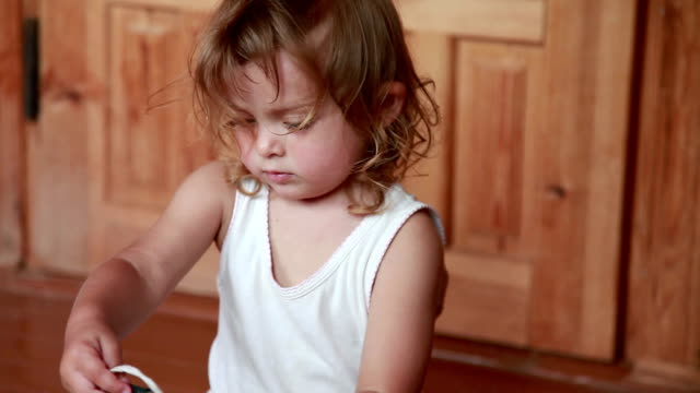 close-up of little girl playing with toys on the floor in the living room - sitting on floor stock videos & royalty-free footage