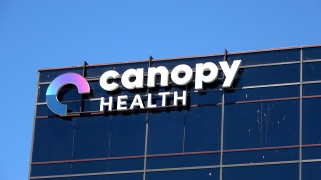 close-up of logo on facade at office of canopy health, a healthcare company in emeryville, california, 2018. - emeryville stock videos & royalty-free footage