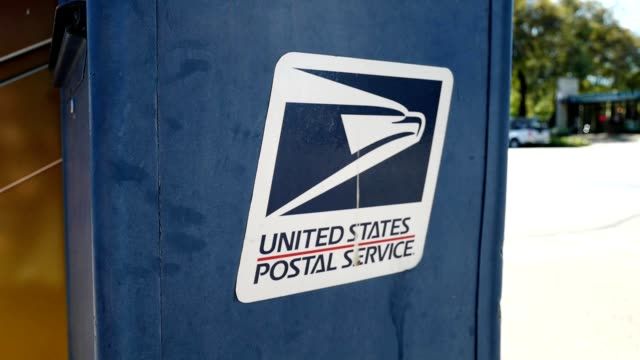 close-up of logo on united states postal service mailbox near road in lafayette, california, july 16, 2019. - united states postal service stock videos & royalty-free footage
