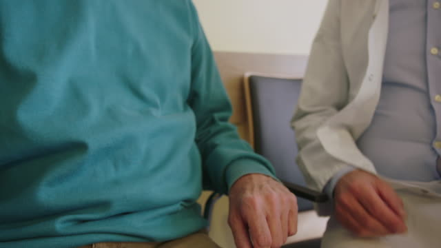 close-up of male doctor shaking hands with patient - clinic stock videos & royalty-free footage