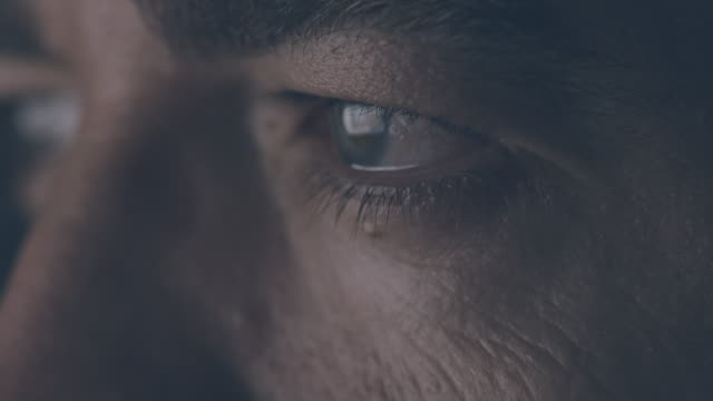 close-up of male eyes - determinazione video stock e b–roll