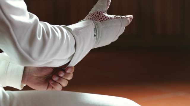 close-up of male fencer wearing white glove - glove video stock e b–roll