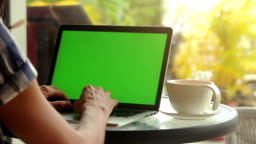 Close-up of male hands using laptop at cafe with green screen, set of 8 shots