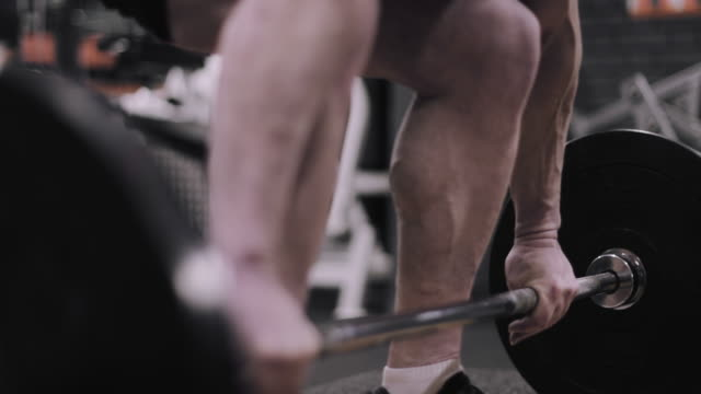 closeup of male weightlifting barbell at the gym - body building stock videos & royalty-free footage