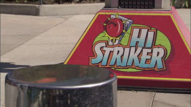 Close-up of mallet at Hi-Striker midway game, Knott's Berry Farm theme park