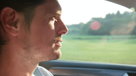 close-up of man driving car during road trip - driver stock videos & royalty-free footage