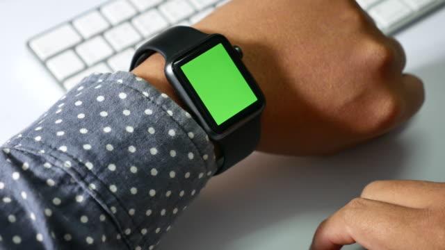 Close-up of Man using smart watch,Green screen