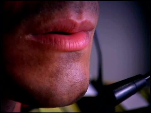 vidéos et rushes de close-up of man - bouche humaine