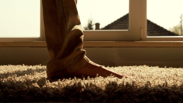 Close-up of man walking on the carpet