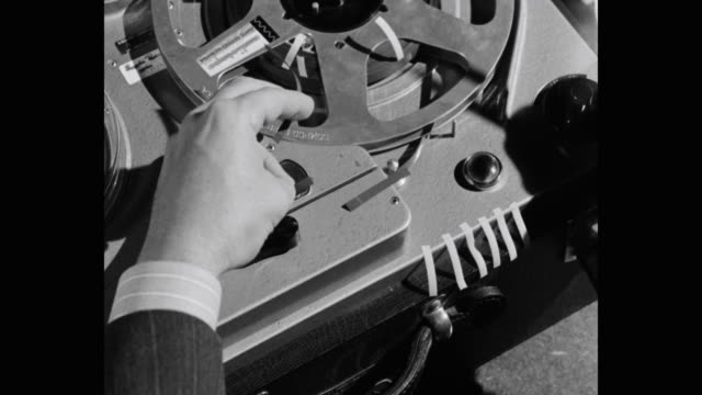 close-up of man's hand cutting and splicing audio tape, paris, france - shears stock videos & royalty-free footage