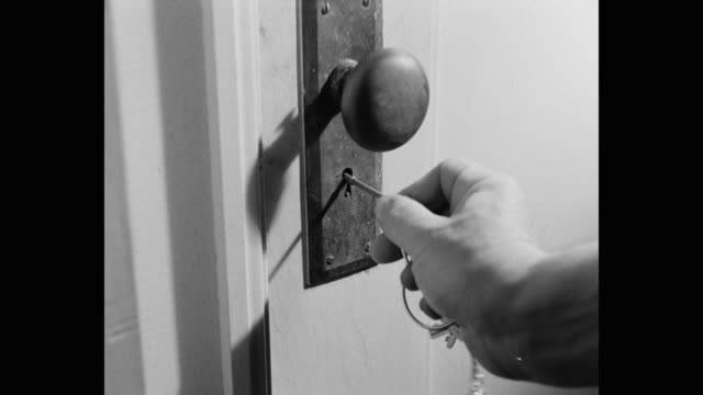 close-up of man's hand locking door with skeleton key - lock stock videos & royalty-free footage